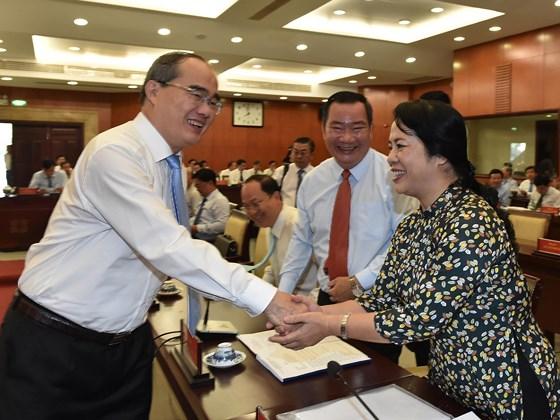 Description: Hội nghị Thành ủy TPHCM bàn kế hoạch nhân sự cho nhiệm kỳ tới ảnh 4