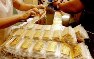 Báo cáo việc làm nhấn chìm giá vàng