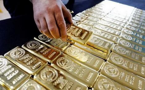 Giá vàng lập đỉnh mới, USD giảm