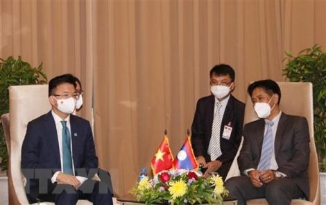 Bộ trưởng Bộ Tư pháp Lê Thành Long gặp Bộ trưởng Bộ Tư pháp Lào
